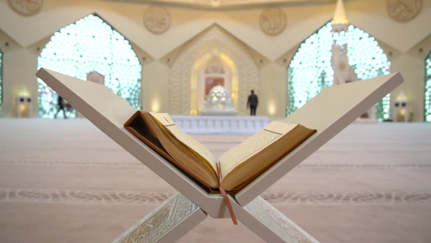 Quran on the reading desk in a mosque. | Shutterstock HD Video #1008487585