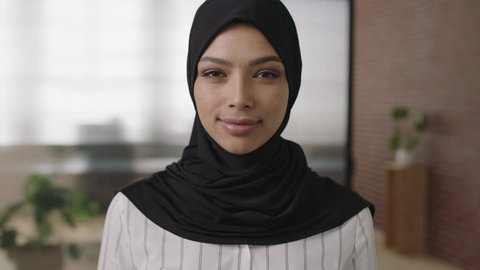close up portrait of young muslim woman laughing cheerful enjoying career opportunity in start up business wearing headscarf real people series