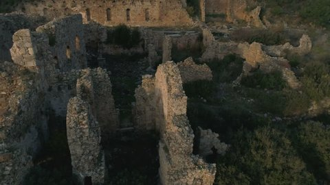 Aerial drone flight. Close-up view of the ruined Syedra Castle during the sunset. Antalya Province in Turkey. 4k, Slow motion.