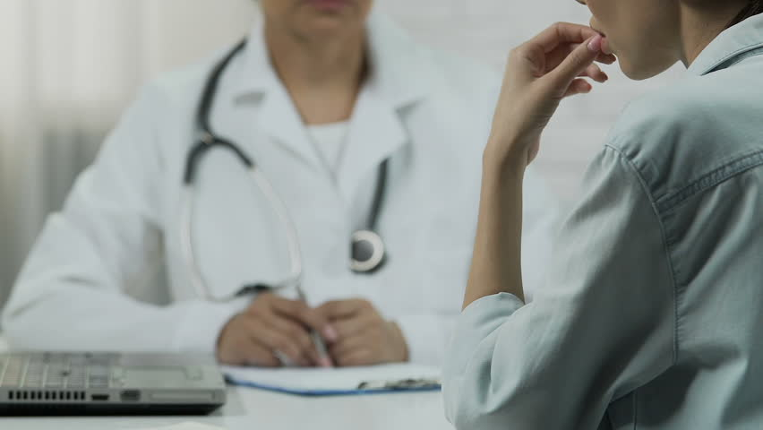 Female patient listening about incurable disease at doctors room, bad news