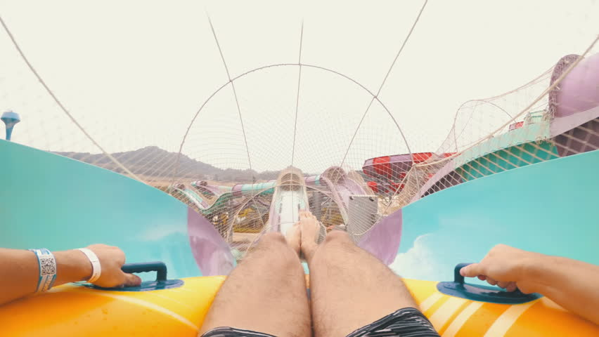 Water slides pov. Man on inflatable ring goes down with water slides. First-person view. Aqua Park of the Ramayana. Thailand. Chest Mount. Slow motion