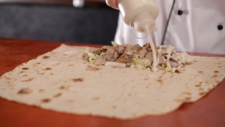 Preparation of shawarma in place of fast food | Shutterstock HD Video #1008669505