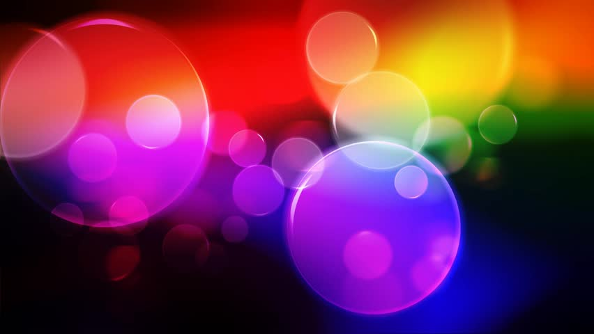 Colorful Circles Video Background Loop . Glassy circular shapes perform a colorful dance.