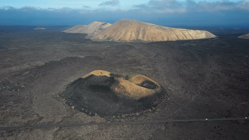 Aerial view of Volcanic valley near Timanfaya National Park and Montana Blanca, Lanzarote, Canary islands, Spain