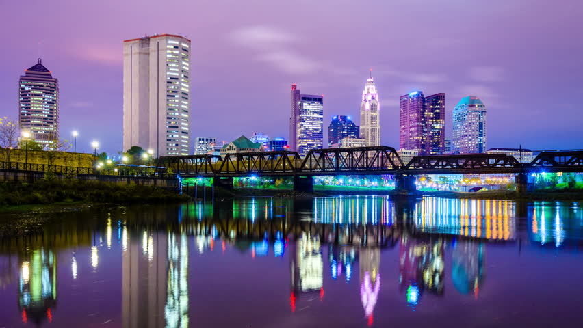 Columbus, Ohio, USA skyline on the Scioto River at dawn.