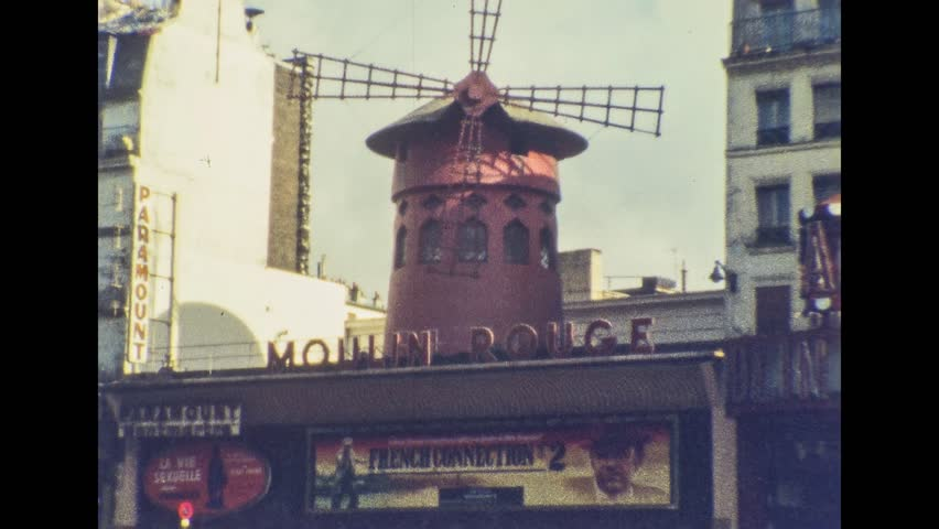 Paris 1970s: Moulin Rouge (Red Mill), the historic tourist attraction in the French capital, on 1967s in Paris, France, Europe | Shutterstock HD Video #1008741995