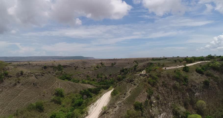 Aerial View of Wavy Green Savanna Mamboro, Sumba Island, Indonesia    Shutterstock HD Video #1008775355
