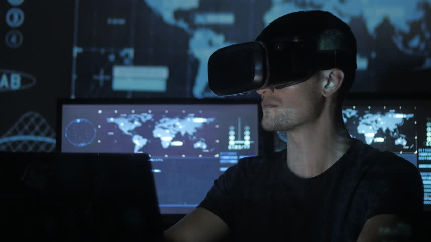 Man hacker programmer uses a virtual reality helmet for programming. IT Technologies of the Future. #1008780395