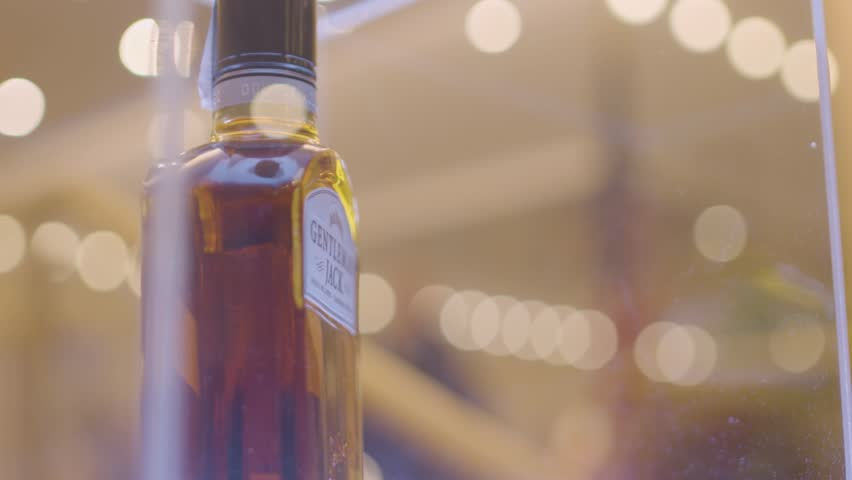Slow motion shot of a whisky bottle. Gentleman's Jack Daniel's | Shutterstock HD Video #1008795725