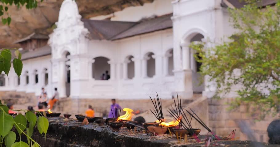 Dambulla Buddhist cave temple under mountain rock. Sri Lanka travel destination background #1008832295