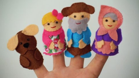 Homemade multi-colored finger dolls. Performance in the kindergarten. Funny puppet show, theater.
