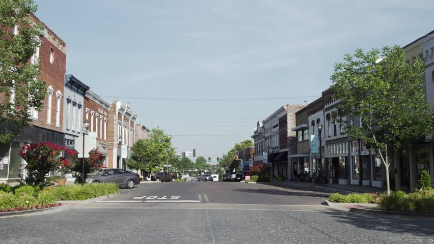 Small town streets on a sunny day | Shutterstock HD Video #1008919355