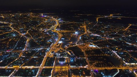 Winter drone shot Minsk city in the night residential and business buildings from above aerial rooftops high