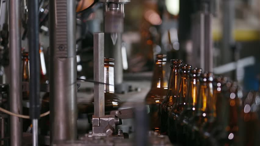 Electronics checks the quality of bottle on glass factory. Sorting beer bottles. Quality control of glass bottles. Technological line for bottling of beer in brewery. Beer bottle factory. Close up. | Shutterstock HD Video #1008979805