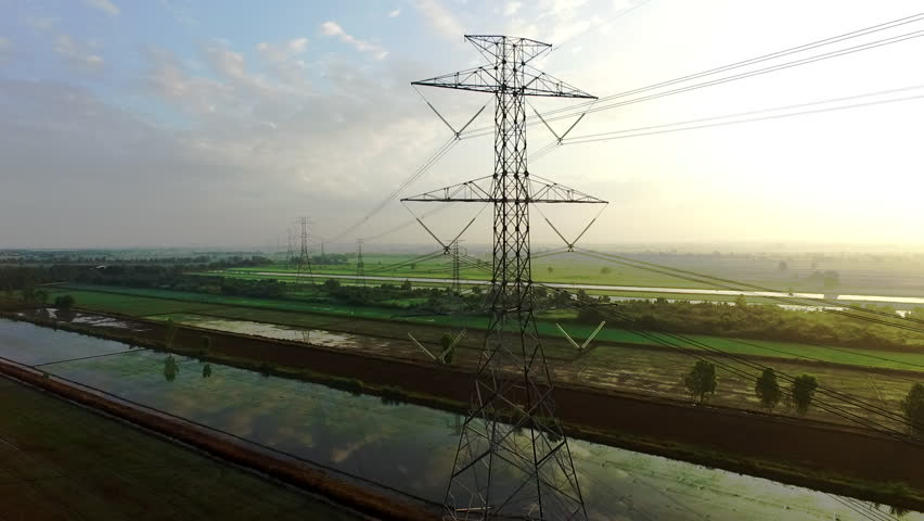 view footage of high voltage electricity tower and power lines under the beautiful sky