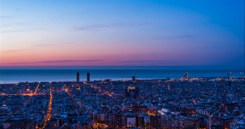 Barcelona Skyline from West to East Night to Day Time Lapse transition.