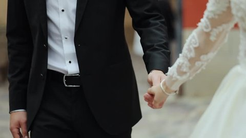 wedding couple walk. Beautiful young couple just entered from the church where they officially became wife and husband and promised to be together for the rest of their life