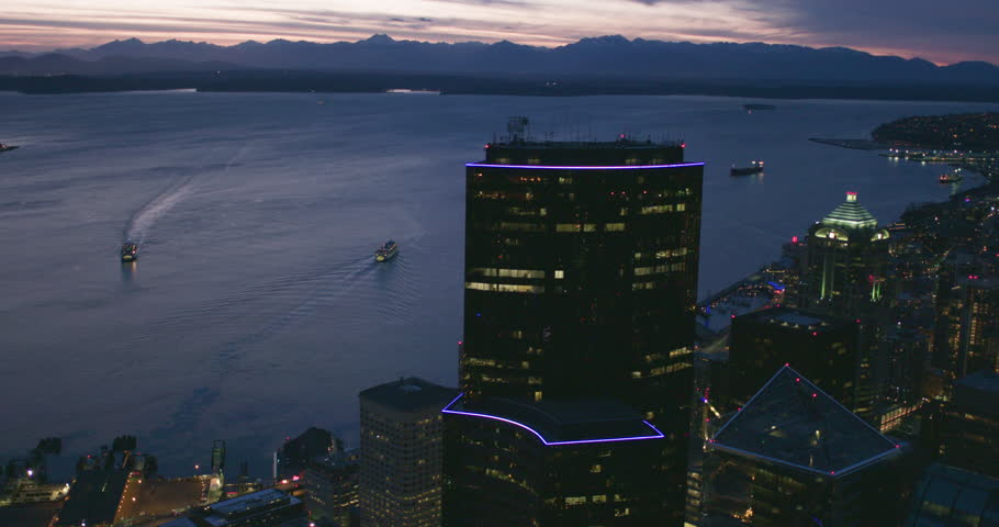 Cinematic Seattle Night Waterfront View Skyscraper Towers Ferry Ships Puget Sound Purple Sun Reflection Olympic Mountain Peaks Horizon Pacific Northwest Establishing Shot Slow Motion