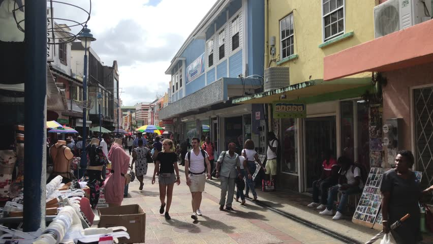 Bridgetown, Barbados, March 26, 2018: View of people walking a pedestrian only street filled with small shops.