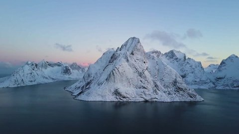 4k Aerial drone footage - Winter sunrise over the beautiful mountains of Reine, Norway.  Lofoten Islands archipelago.