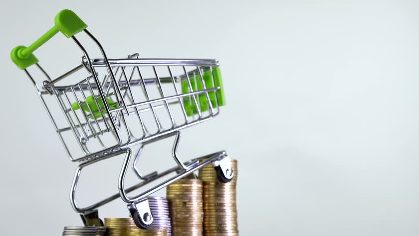 Shopping cart or market basket on stack of money coins isoleted on white background. Concept of online store | Shutterstock HD Video #1009264145