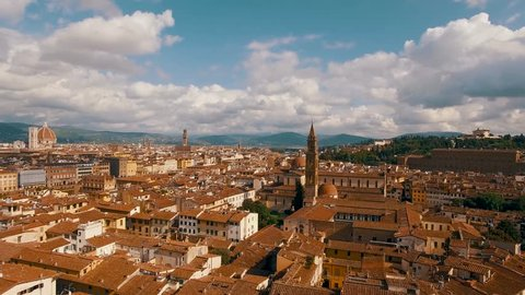 Aerial drone panorama circling around the Basilica di Santa Spirito in Florence on a sunny day