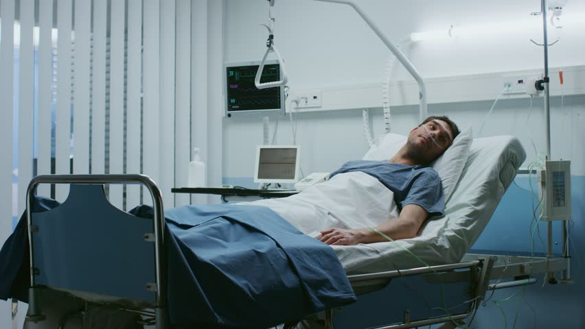 In the Hospital, Sick Male Patient Lies on a Bed, Fighting the Disease. Clean and Comfortable Medical Ward. Shot on RED EPIC-W 8K Helium Cinema Camera. | Shutterstock HD Video #1009295615