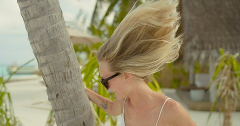 Beautiful Playful Woman Hides Behind the Palm Tree. Romantic Vacation on the Warm Exotic Location Near the Sea and Authentic Village. Shot on RED Epic 4K UHD Camera.