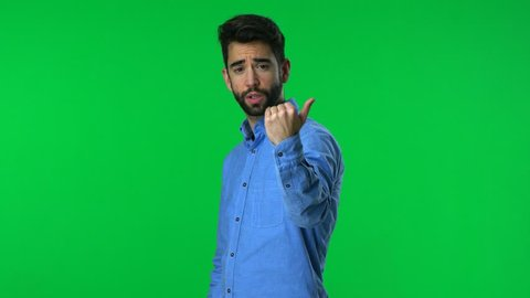 man come here gesture over a green screen background