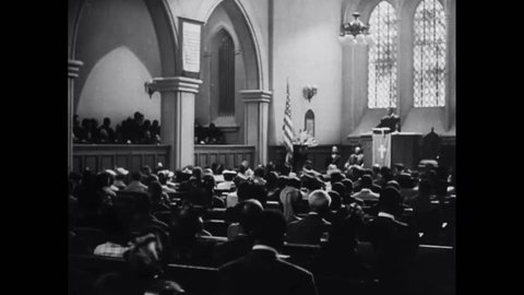 CIRCA 1940s - An African American priest presides over a church service to honor black soldiers in World War Two.