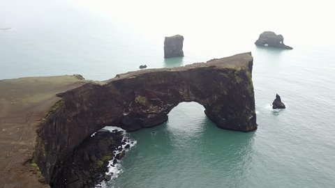 The small peninsula, or promontory, DyrhÌ_laey is located on the south coast of Iceland