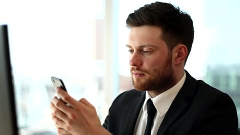 Businessman chating on phone. Serious face