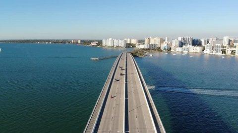 A drone view across the John Ringling Causeway heading towards Downtown Sarasota, Florida.