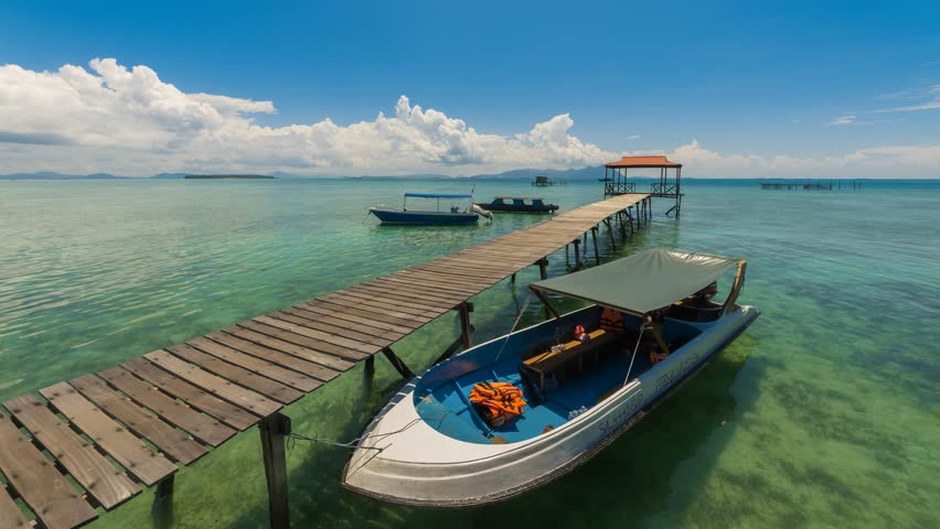 SEMPORNA, SABAH - CIRCA APRIL 2017: Time lapse of day jetty view with dancing clouds and motion blur at Salakan Island, Semporna, Sabah, Malaysia. 4K resolution #1009401065