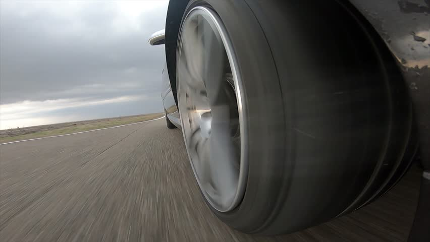 Car wheel with incandescent ceramic brakes and  sparks on race track with sound
