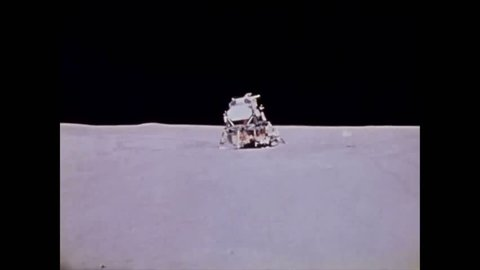 CIRCA 1971 - Dave Scott conducts two final experiments before him and Jim Irwin prepare to leave the lunar surface on Apollo 15.