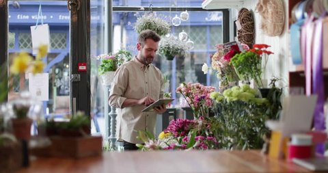 Small business owner using digital tablet in a florist