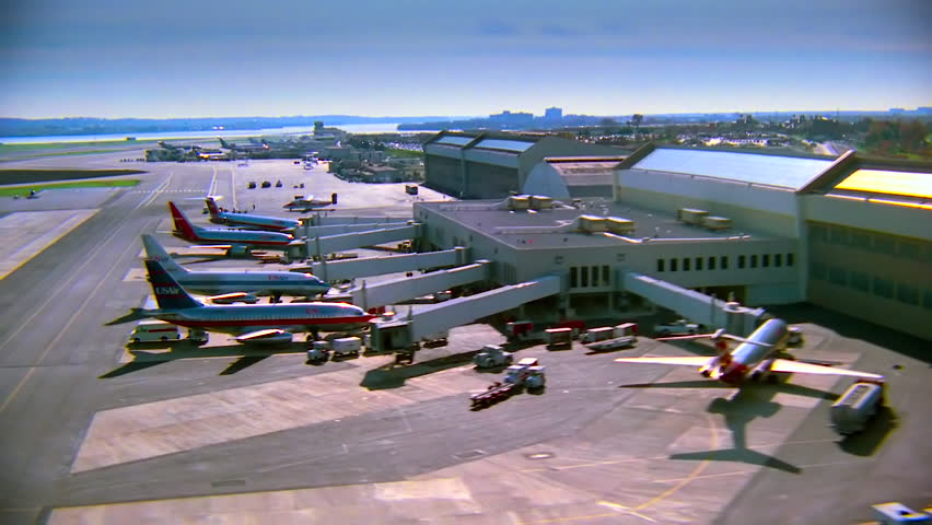 WASHINGTON DC - CIRCA 1990s - 1990s - Aerial over US Airways jets parked at Ronald Reagan International airport in Washington D.C.