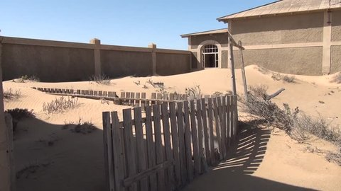 HD high quality summer day video of abandoned diamond mining town of Kolmanskop located near coastal harbour town Luderitz in the Namib Desert Sperrgebiet area in the south of Namibia, southern Africa
