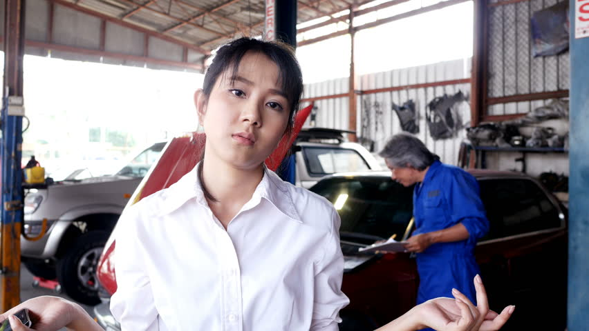 Asian woman boring about car problem. people with car service, repair and maintenance concept. #1009489025