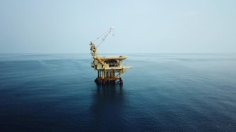 Aerial view from a drone of a small offshore platform in the middle of the ocean