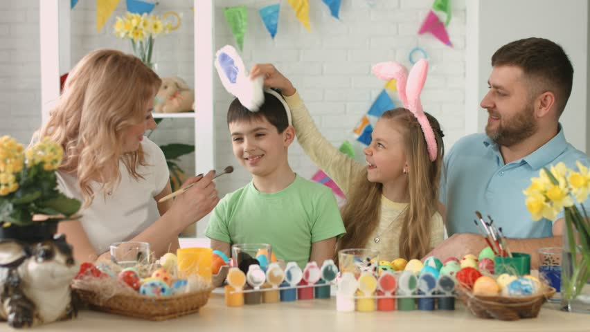 Portrait of happy friendly family with two children during Easter celebration | Shutterstock HD Video #1009655495