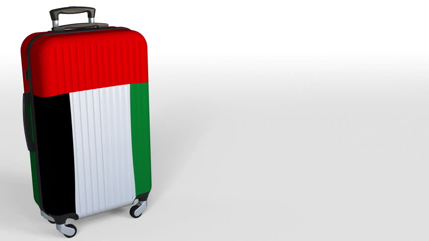 Traveler's suitcase featuring flag of the United Arab Emirates. UAE tourism conceptual animation, blank space for caption   Shutterstock HD Video #1009663625