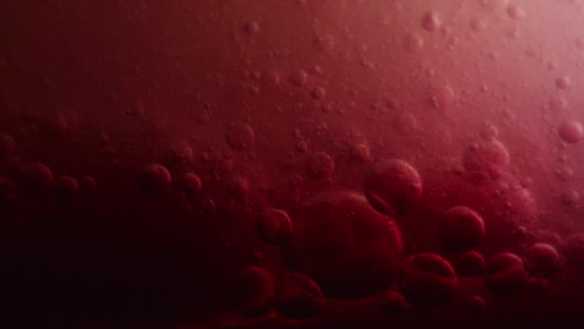 Bubbles surging and pumping; red color reminiscent of blood and plasma fluids.