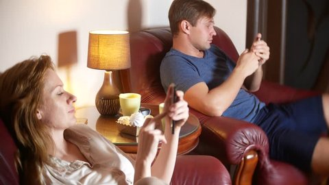 Internal and communication problem in the family. husband and wife use their smartphone, ignoring each other. 4k.