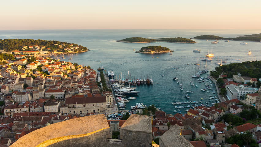 Day to Night Time Lapse of Hvar Town, Croatia. Hvar is a city and port on the island of Hvar, part of Split-Dalmatia, Croatia. Hvar has a history as center for Croatia trade, culture and travel.