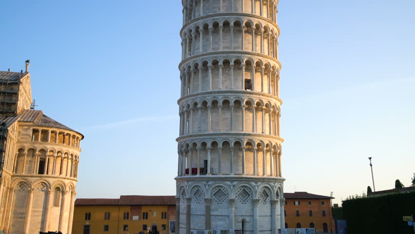 Leaning Tower of Pisa in Pisa, Italy. Leaning Tower of Pisa known worldwide for its unintended tilt , travel destination of Italy. The bell tower is situated behind The Pisa Cathedral.   Shutterstock HD Video #1009688375