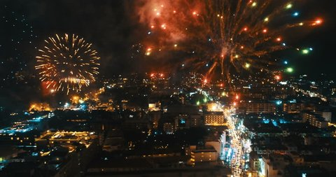 Aerial drone view of fireworks above the city on New Year's Eve - video in slow motion