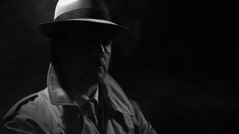 Retro noir film character: confident investigator standing in the dark and adjusting his trench coat