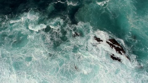 Real time shot of sea surf. Aerial top down view.